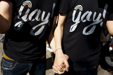 Gay couple hold hands during Tokyo Rainbow Pride parade in Tokyo