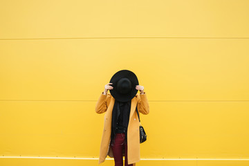 Faceless woman with hat Wall mural