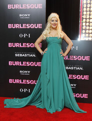 """Cast member Aguilera poses at the premiere of """"Burlesque"""" at the Grauman's Chinese theatre in Hollywood"""