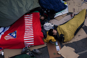 Demonstrators sleep as they camp out in Madrid's Puerta del Sol two days after Spanish regional and local elections
