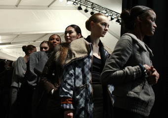 Models wait for rehearsal backstage at the Max Azria Fall 2010 collection during New York Fashion Week