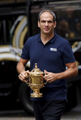 Former England captain Martin Johnson arrives with the Webb Ellis Cup, trophy of the Rugby World Cup, in Downing Street in London, Britain