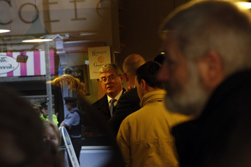 Irish Labour Party leader Eamon Gilmore meets customers of a coffee shop as he canvasses in the town of Drogheda, County Lout