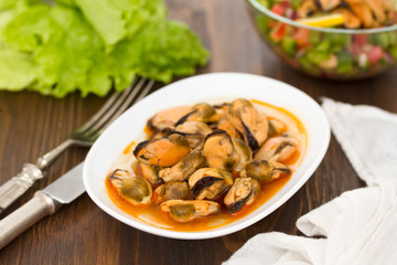 mussels in sauce on white dish