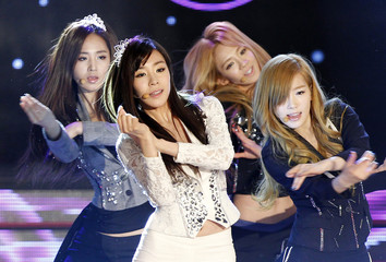Members of K-Pop idol group Girls' Generation perform during the Korean Pop Culture and Art Awards at the Olympic Hall in Seoul