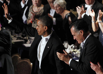 U.S. Republican presidential nominee and former Massachusetts Governor Romney applauds U.S. President Obama at the Alfred E. Smith Memorial Foundation dinner in New York