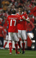 Benfica's Oscar Cardozo celebrates his goal with Martins during the first leg of their Europa League semi-final soccer match against Braga at Luz stadium in Lisbon