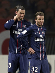 Paris St-Germain's Beckham and team mate Ibrahimovic look on during the Ligue 1 soccer match against Montpellier at the Parc des Princes Stadium in Paris