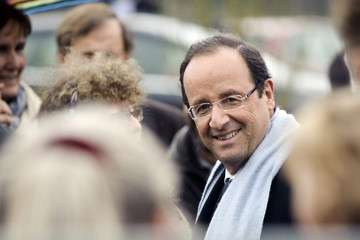 Francois Hollande, Socialist Party candidate for the 2012 French presidential election, visits working class garden plots during a campaign visit near Besancon