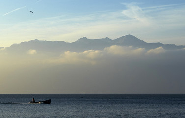 A fisherman sails early morning on Lake Leman in Lutry