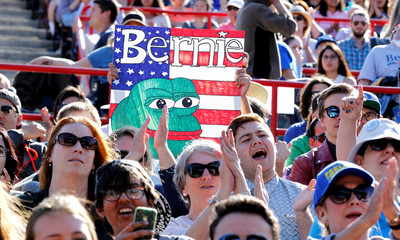 People cheer at a campaign rally for U S. Democratic presidential candidate Bernie Sanders in Irvine, California