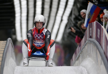Austria's Kindl comes to a stop after a run in the men's singles luge competition at the 2014 Sochi Winter Olympics