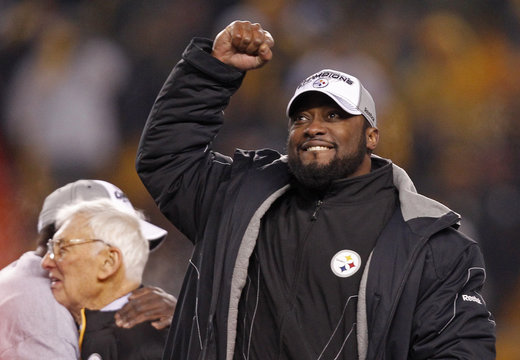Pittsburgh Steelers head coach Tomlin celebrates as team owner Rooney is hugged in the background after the Steelers defeated the New York Jets in the NFL AFC Championship football game in Pittsburgh
