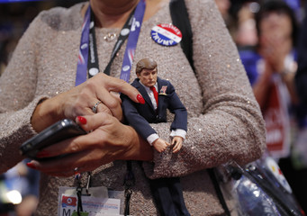 A delegate holds a Donald Trump doll during the second day of the Republican National Convention in Cleveland