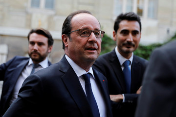 French President Francois Hollande arrives to attend a conference organised by EuropaNova, a European think tank, at MINES ParisTech school in Paris