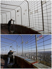 A combo shows a visitor using binoculars to see the city of Beijing at a viewing deck on the China Central Radio and Television Tower on a smoggy day and a sunny day