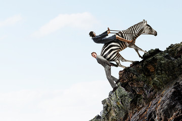 Fototapete - Businesswoman ride zebra. Mixed media