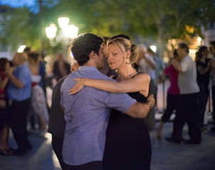 Couples dance during an open-air initiation tango and milonga sessions organized by TNT Tango at the Kiosque Lumiere in Lyon
