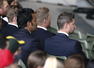 India's captain Mahendra Singh Dhoni and Australia's captain Michael Clarke watch ICC Cricket World Cup 2015 opening event at the Sidney Myer Music Bowl in Melbourne