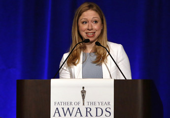Chelsea Clinton introduces her father, former U.S. president Bill Clinton, as he is named 'Father of the Year' at a lunch in New York