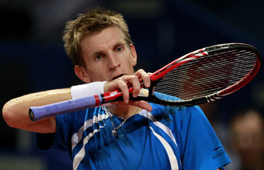 Finland's Nieminen reacts during his match against Djokovic of Serbia at the Swiss Indoors ATP tennis tournament in Basel