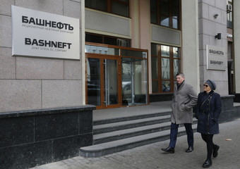 People walk past headquarters of Bashneft oil company in Moscow