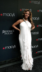 Singer Beyonce poses for a photo while she arrives to debut her newest fragrance Beyonce Pulse at Macy?s store in New York