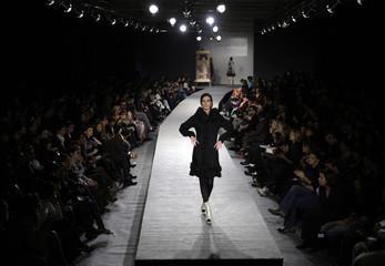 A model presents a creation by Georgian designer Vardanashvili during Georgian Fashion Week in Tbilisi