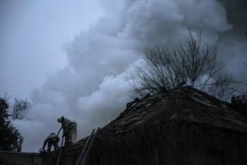Firefighters extinguish a building after shelling in Artemivsk