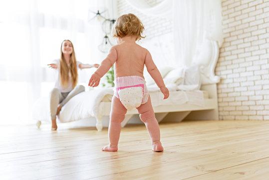 Pretty little girl learning to walk