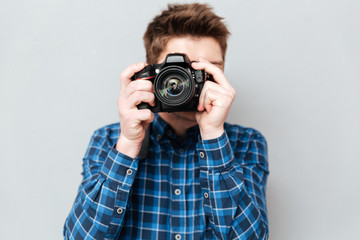 Close up of camera in man's hands isolated