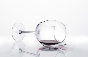 Broken glass of wine