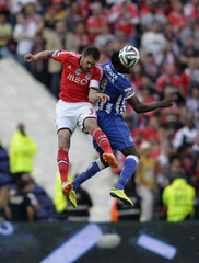 Porto's Jackson jumps for the ball with Benfica's Nivaldo during their Portuguese Premier League soccer match at Dragao stadium in Porto