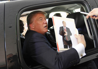 Real estate magnate Trump signs autographs outside a Greater Nashua Chamber of Commerce business expo in Nashua