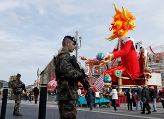 French soldier stand guard before the start of the 133rd Nice carnival, the first major event since the city was attacked during Bastille Day celebrations last year, in Nice