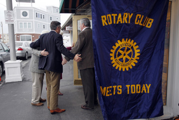 Jon Huntsman is greeted by members of the Hampton Rotary Meeting as he arrives at a campaign event with the Hampton Rotary Club at the Ashworth Hotel in Hampton