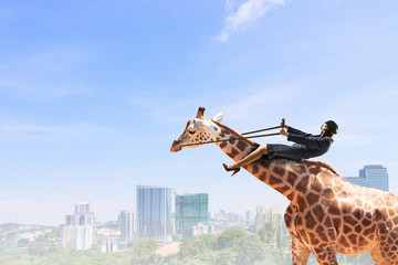 Fototapete - Woman ride giraffe