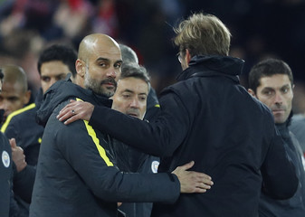 Liverpool manager Juergen Klopp and Manchester City manager Pep Guardiola after the game