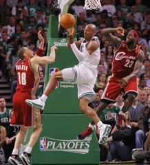 Celtics Allen passes off the ball between Cavaliers  Parker and James during Game 6 of their NBA Eastern Conference playoff basketball series in Boston