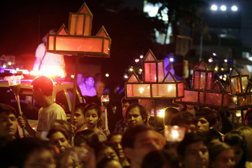 "Catholic hold candles during the ""Via Crucis"" re-enactment in Holy Week procession, in preparation for Good Friday celebrations, in Luque"