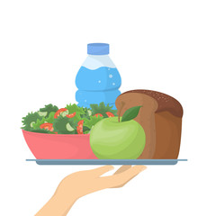 Hand holds healthy meal.