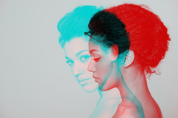 Double Color Exposure Effect of Beauty closeup profile portrait of beautiful mixed race caucasian - african american woman