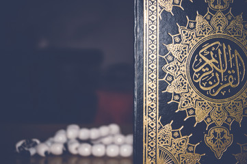 quran with beads, ramadan concept, selective focus