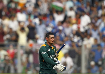 South Africa's Quinton de Kock walks off the field after India's Suresh Raina dismissed him during their fifth and final one-day international cricket match in Mumbai