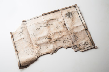 Close up to vintage map with fake island of Pirates treasure