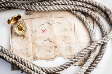 Marine rope around vintage map with red cross and gold compass