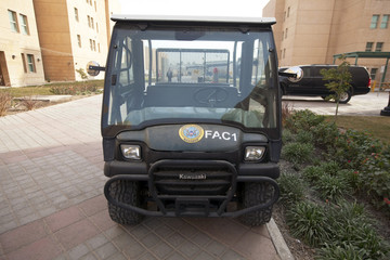 A landscaping vehicle with a U.S. State Department logo sits parked inside the compound of the U.S. embassy in Baghdad