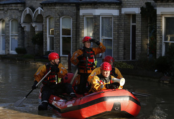 Emergency services navigate a flooded street in York, northern England