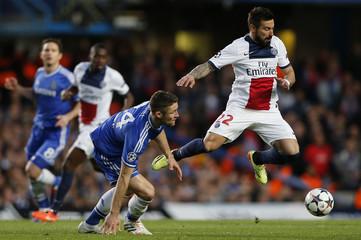Chelsea's Cahill challenges Paris St Germain's Lavezzi during their Champions League quarter-final second leg soccer match at Stamford Bridge in London