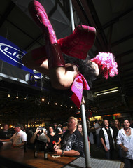 Anastashia Powell of the beer girl troupe Hell's Belles, performs on a dance pole at Suck Bang Blow biker bar in Murrells Inlet
